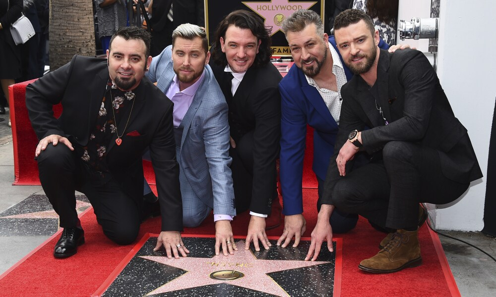Chris Kirkpatrick, from left, Lance Bass, JC Chasez, Joey Fatone and Justin Timberlake of the band NSYNC appear at a ceremony honoring them with a star on the Hollywood Walk of Fame on Monday, April 30, 2018, in Los Angeles. (Photo by Jordan Strauss/Invision/AP)