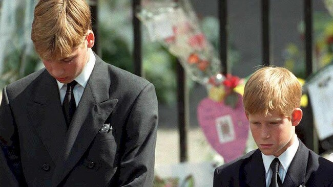 All eyes were on the brothers at Diana's funeral in 1997. Picture: Adam Butler