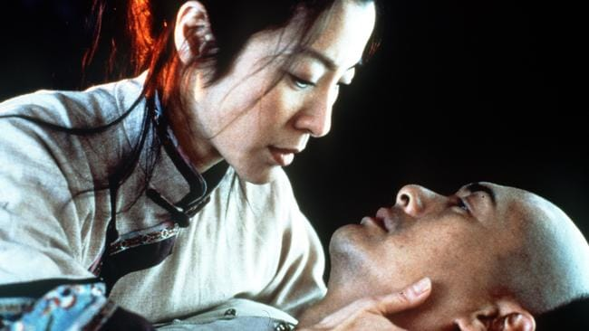 Actors Michelle Yeoh and Chow Yun-Fat in a scene from  <i>Crouching Tiger Hidden Dragon</i>.