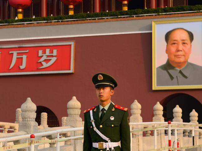 People's Armed Police officer with portrait of Mao Zedong at Tiananmen Gate of Heavenly Peace Beijing. Picture: Supplied