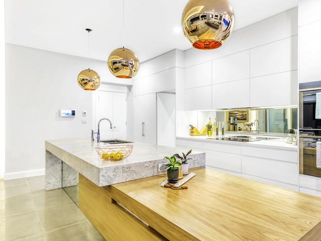 The award-winning kitchen features a limestone an timber bench top