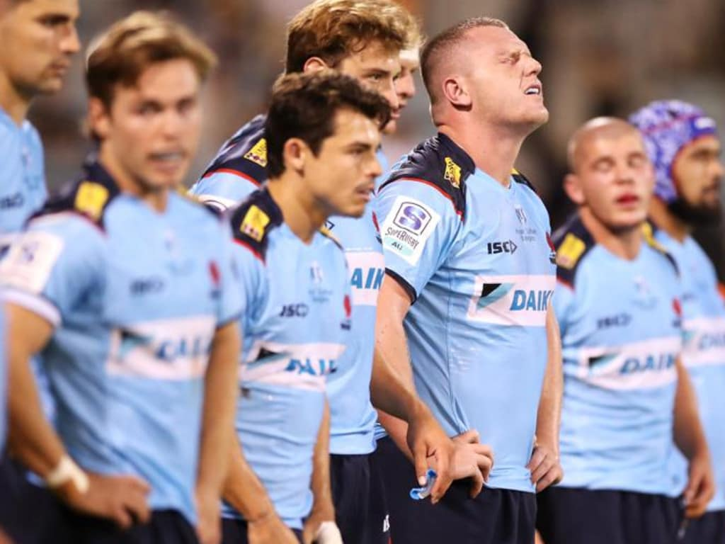 CANBERRA, AUSTRALIA - FEBRUARY 27: Angus Bell of the Waratahs and his team mates look dejected after a Brumbies try during the round two Super RugbyAU match between the Brumbies and the Waratahs at GIO Stadium, on February 27, 2021, in Canberra, Australia. (Photo by Mark Kolbe/Getty Images)