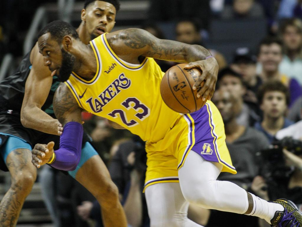 Los Angeles Lakers forward LeBron James (23) drives against Charlotte Hornets guard Jeremy Lamb in the first half of an NBA basketball game in Charlotte, N.C., Saturday, Dec. 15, 2018. (AP Photo/Nell Redmond)