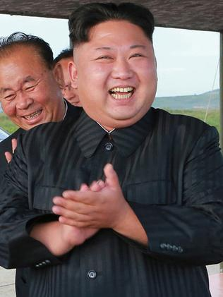 Kim Jong-un celebrates launch of Hwasong-12 missile at an undisclosed location in North Korea. Picture: AP