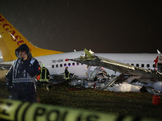 The plane skidded off the runway, crashing into a field and breaking into pieces. Picture: AP