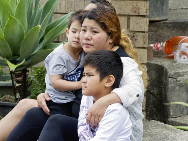 Relatives of Henry Tran, 2, at his Fairfield home where he was found in a pond. Picture: Jenny Evans
