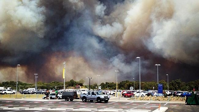 Fire threatens Williamtown airport. Picture: Craig Meyers/Twitter