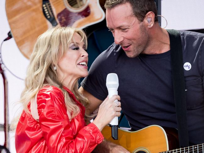 Kylie Minogue and Chris Martin of Coldplay sing Can't Get You Out of My Head. Picture: Getty.