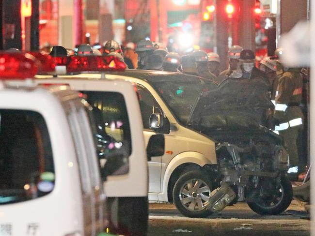 Police inspect a car whose driver rammed his vehicle into crowds on Takeshita street in Tokyo.