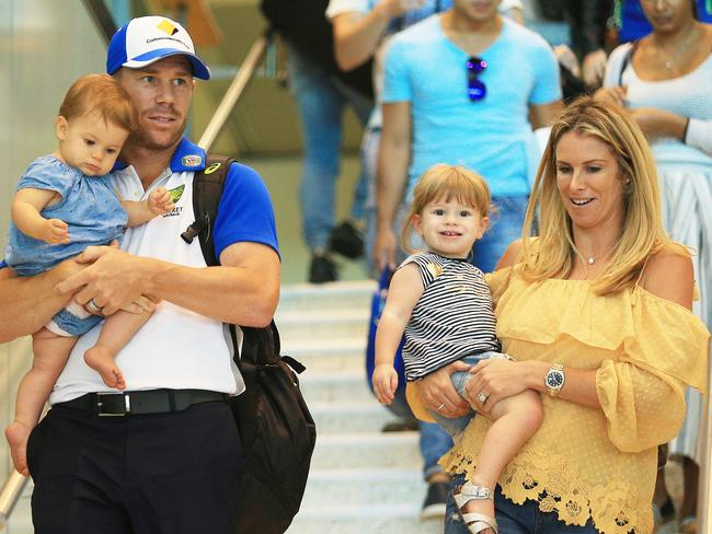 Dave Warner carrying daughter Indie Rae with wife Candice and Ivy Mae.