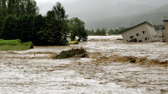 Floodwaters from the Sorachi river wash away a building after embankments of the river were broken in Minami-furano, the northern island of Hokkaido, Japan. Picture: Risa Ominato/Kyodo News via AP