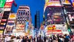 Crowded streets of Shinjuku shopping district with blurred commuters at dusk Picture: iStock