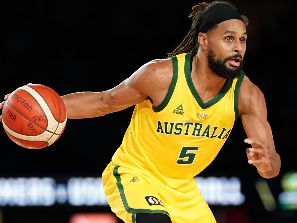 Patty Mills of Australia controls the ball during match 2 of the Pre-FIBA World Cup series between Australia and the USA  at Marvel Stadium in Melbourne, Saturday, August 24, 2019.  (AAP Image/Scott Barbour) NO ARCHIVING, EDITORIAL USE ONLY