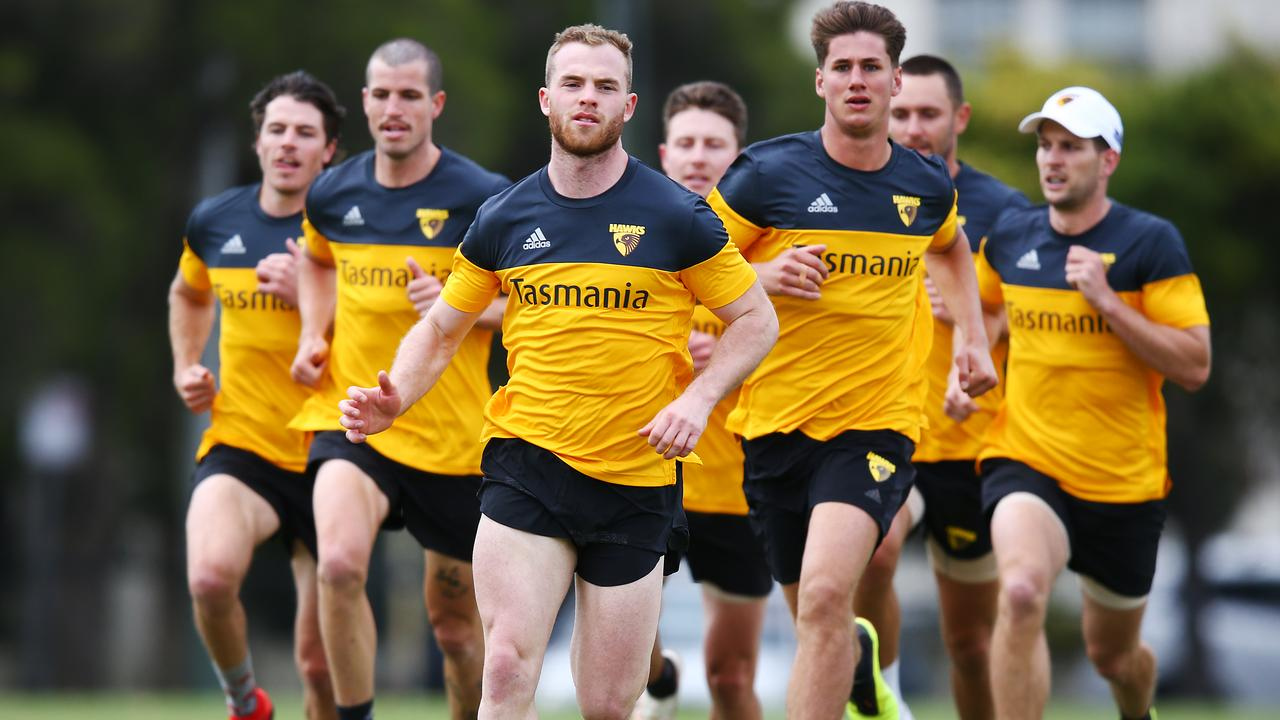 Tom Mitchell of the Hawks leads a running session at Xavier College on Monday.