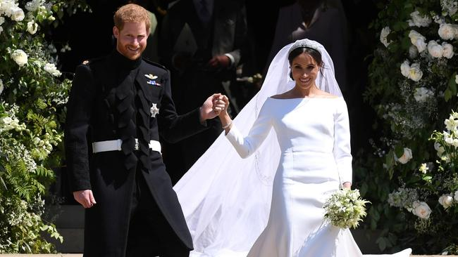 Prince Harry and Meghan's wedding outfits are on display in the UK. Credit: Neil Hall/Pool via Reuters