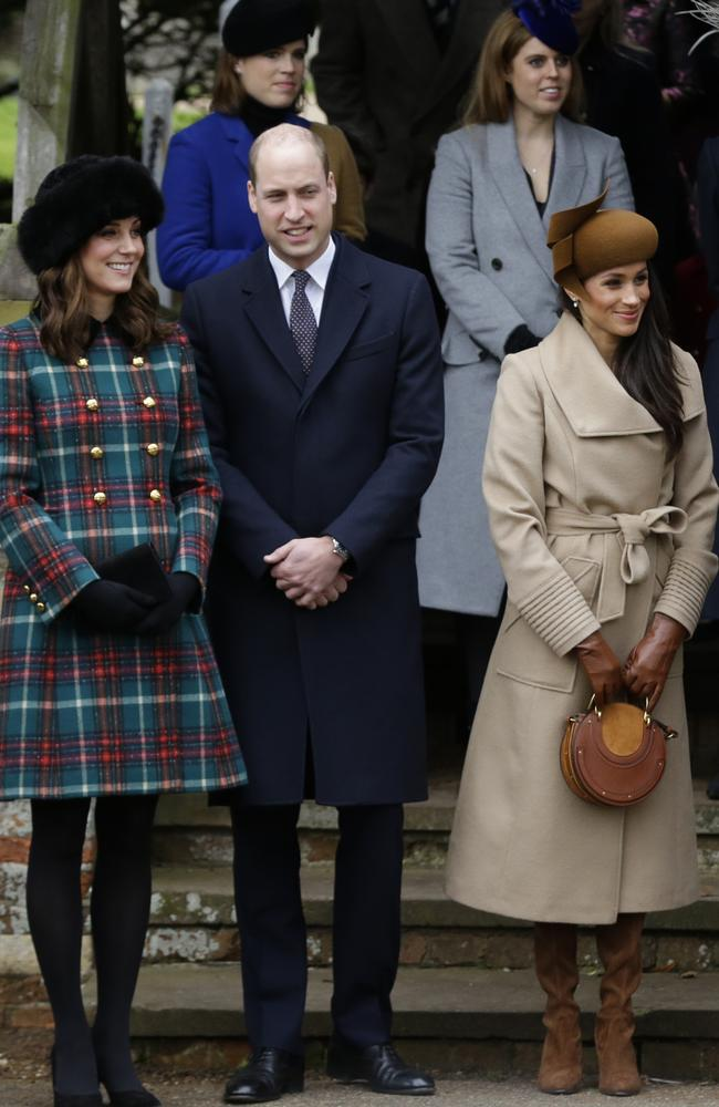 Britain's Kate, Duchess of Cambridge, left, with Prince William and Meghan Markle the fiancee of Prince Harry, right, wait for the Queen to leave by car following the traditional Christmas Day church service. Picture: AP