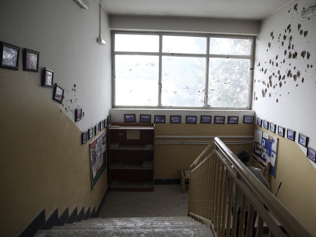 Bullet holes line the hospital wall. Image: AP
