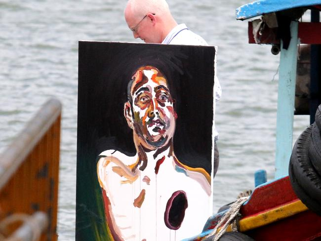 Haunting ... Australian lawyer Julian McMahon brings a painting back from visiting Sukumaran in Nusakambangan. Picture: Lukman S Bintoro.