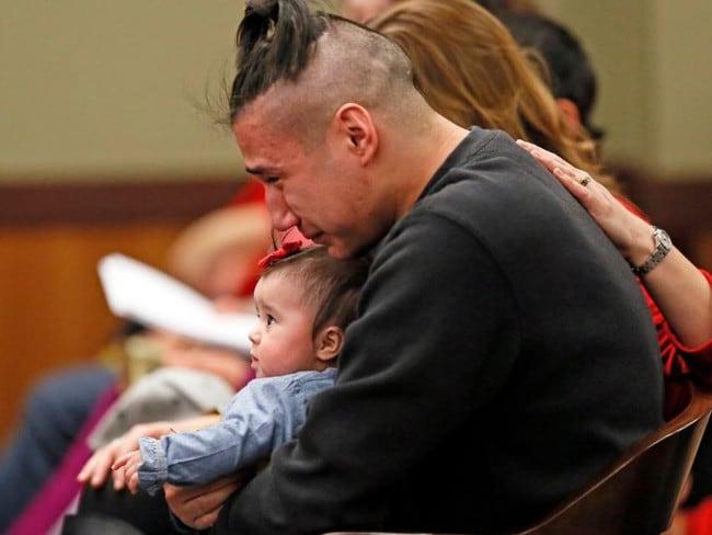 Savanna LaFontaine-Greywind's boyfriend Ashston Matheny holds their daughter Haisley Jo. Picture: David Samson/The Forum