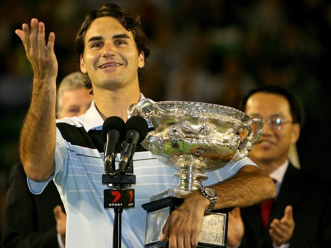 Federer gestures toward former champion Ken Rosewall.