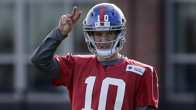 New York Giants quarterback Eli Manning participates in practice.