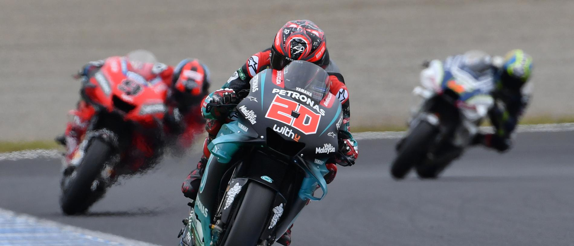 Petronas Yamaha SRT rider Fabio Quartararo of France (C) leads Ducati Team rider Danilo Petrucci of Italy (L) during the second free practice session at the Twin Ring Motegi circuit in Motegi, Tochigi prefecture on October 18, 2019. (Photo by TOSHIFUMI KITAMURA / AFP) (Photo by TOSHIFUMI KITAMURA/AFP via Getty Images)