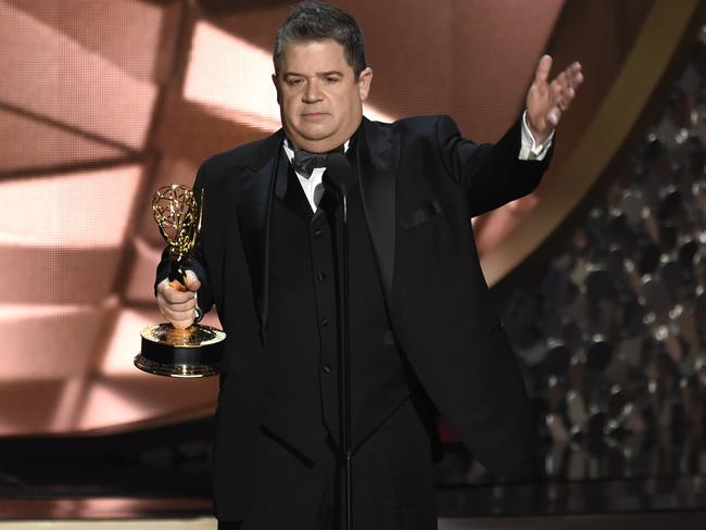 Patton Oswalt accepts the award for outstanding writing for a variety series at the 2016 Emmys.