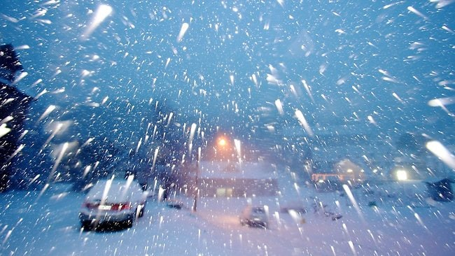 Blizzards have hit the Victorian Alps as a deep low pressure system off Tasmania sweeps the southern states bringing high winds, heavy rain, snow and hail. Picture: Hocking Chris