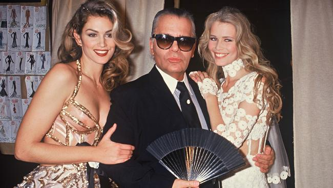 Cindy Crawford, Karl Lagerfeld and Claudia Schiffer, during the Chanel fashion show in Paris, 1993. Picture: Rindoff Petroff/Castel/Getty Images