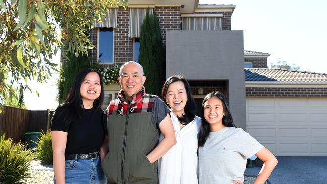 Amanda, Nicholas, Noni and Amber Chan with the house they built in South Morang. Nicholas said doing plenty of research helped him avoid surprise costs. Picture: Josie Hayden