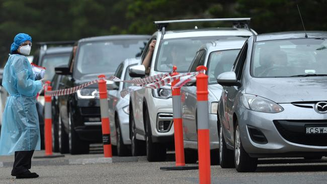 Northern beaches residents attend a drive thru pop up testing clinic at Newport Beach. Picture: Jeremy Piper