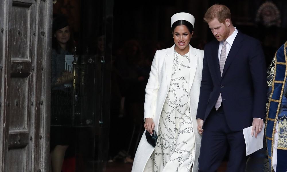 FILE - This March 11, 2019 file photo shows Meghan, the Duchess of Sussex and Britain's Prince Harry leave after attending the Commonwealth Service at Westminster Abbey on Commonwealth Day in London. With another royal baby on the horizon, the debate over postpartum perfection is alive and well. As it stands, we don't know whether Meghan Markle will follow in the footsteps of Kate Middleton when it comes to that magical perfection, but we have an inkling she'll at least slap on some makeup when she introduces the latest royal to the world next month. (AP Photo/Frank Augstein, File)