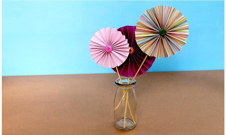 "These sweet folded flowers are a simple way to make paper flowers for Mother's Day – or just for a fun rainy day activity!  <a href=""https://www.youtube.com/watch?v=PvkqEyd9gx0"">Easy folded flowers</a>"