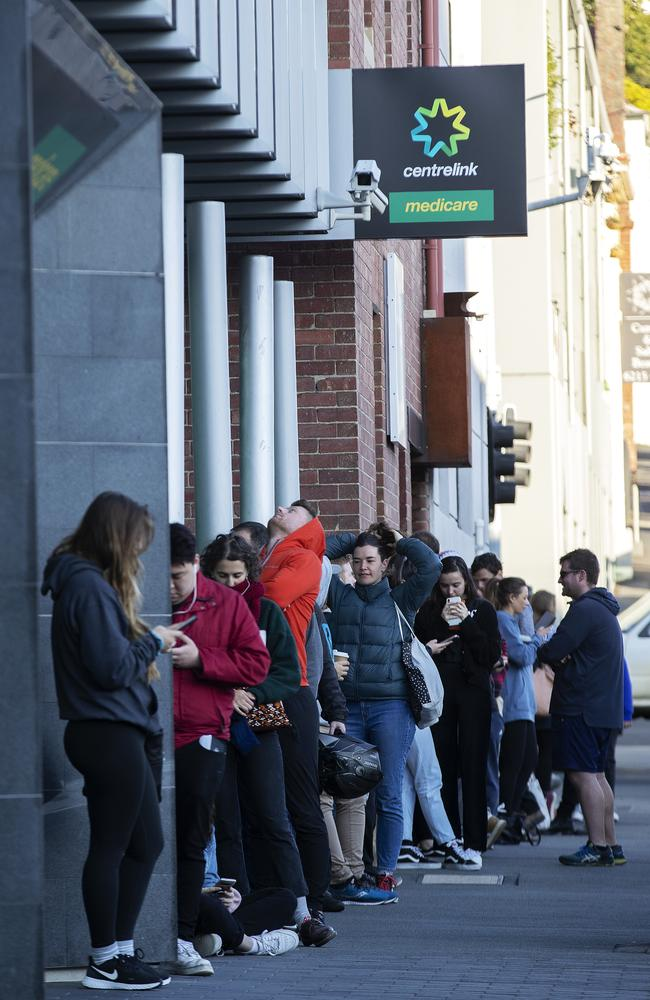 People line up outside the Centrelink office at Hobart, Tasmania. Picture: Chris Kidd