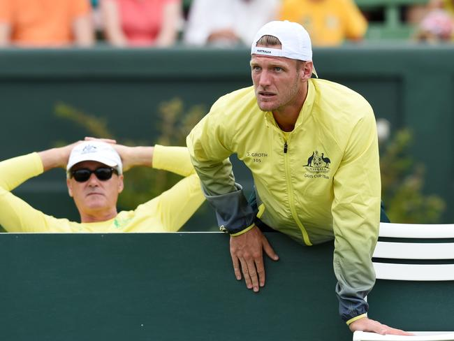 Sam Groth watches Australia's Davis Cup doubles match against the USA.