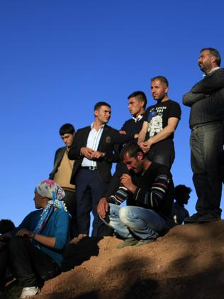 People mourn Kurdish fighters killed in clashes against IS. Gokhan Sahin/Getty Images.