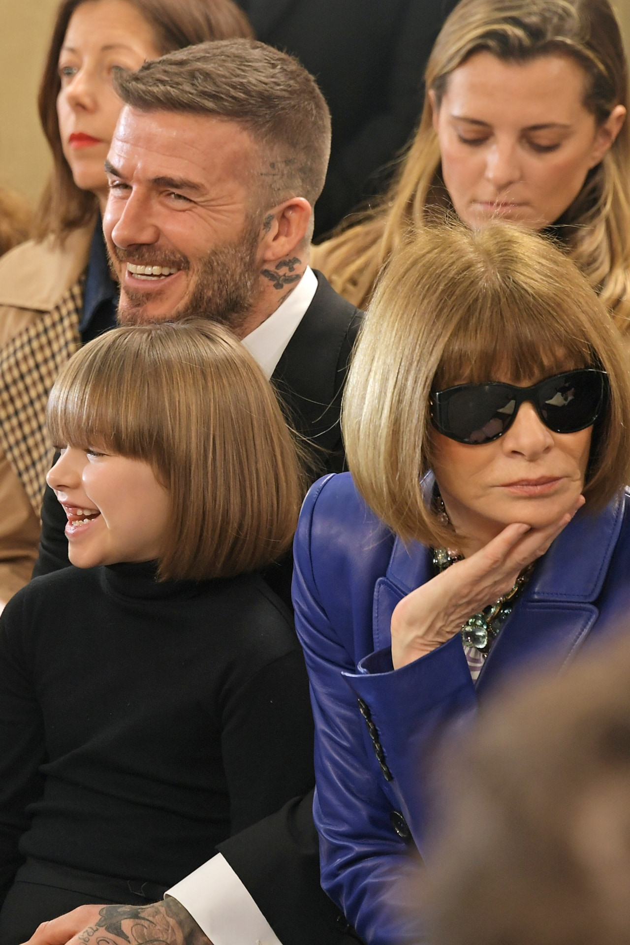Harper Beckham, David Beckham and Dame Anna Wintour attend the Victoria Beckham show during London Fashion Week February 2019 at Tate Britain on February 17, 2019 in London, England. Image credit: David M. Benett/Dave Benett/Getty Images