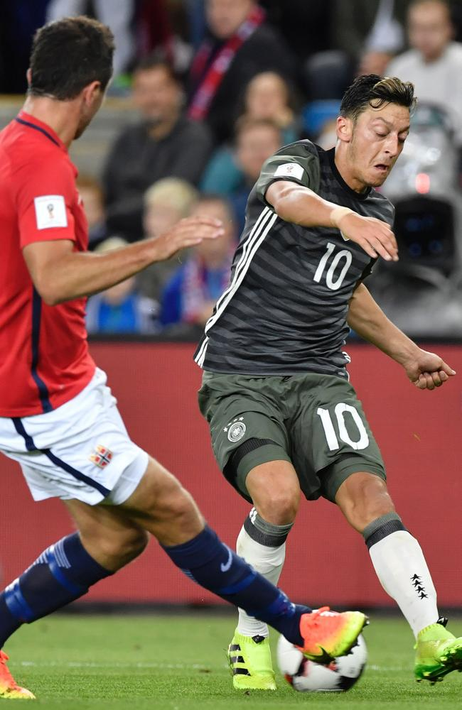 Germany's midfielder Mesut Ozil (R) vies with Norway's Even Hovland.