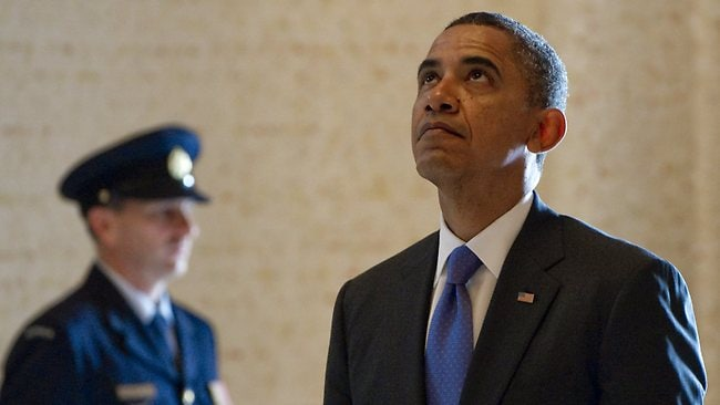 Barack Obama pauses during a moment of silence at the Australian War Memorial in Canberra. Picture: AFP
