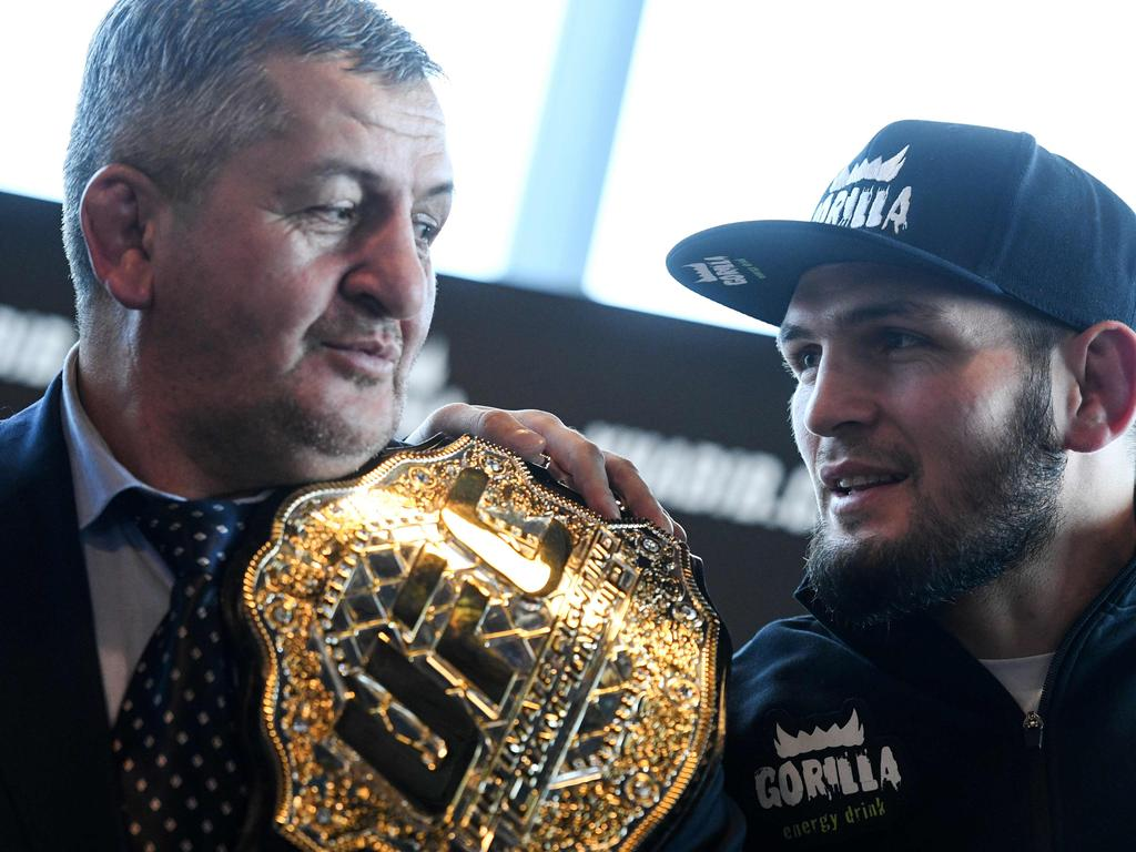 (FILES) In this file photo taken on November 26, 2018 Mixed martial arts (MMA) fighter Khabib Nurmagomedov and and his father Abdulmanap Nurmagomedov give a press conference in Moscow. - Russian MMA fighter Khabib Nurmagomedov has appealed to residents of his native Dagestan to follow containment rules, as his father was put on a ventilator after being infected with the coronavirus. (Photo by Kirill KUDRYAVTSEV / AFP)