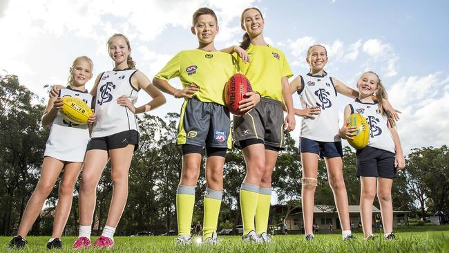 The Aussie Rules season is on hold for Charlotte Kulmar, 9, Sophie Kulmar, 11, Jamie Jones, 13, Sara Jones, 16, Alexandra Hicks, 11, and Isabella Hicks, 8, pictured at Acron Oval in St Ives. Picture: AAP/Troy Snook