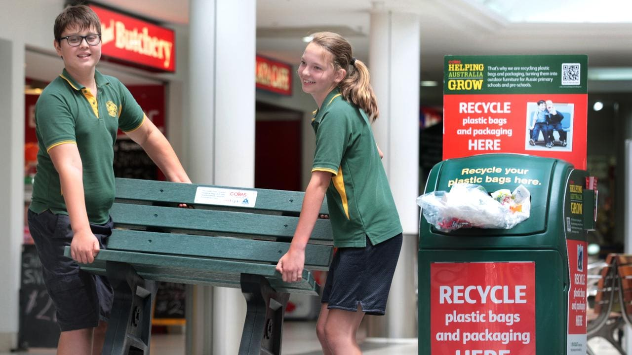 Woodville Primary students, Sally Thompson, 12, and Adrian Altus, 11, at the Welland Plaza shopping centre to collect their bench made from soft plastics recycled in the REDcycle program. Coles and Replas are donating the benches to schools around Australia.