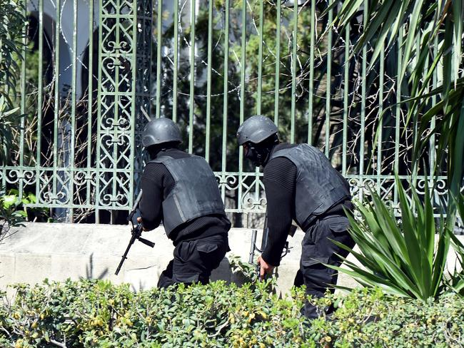 On the move ... Tunisian security forces secure the area. Picture: AFP/ Fethi Belaid