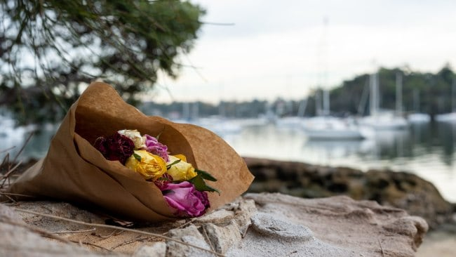 Flowers laid in honour of Cecilia Haddad near Lane Cove River shoreline where she was found.