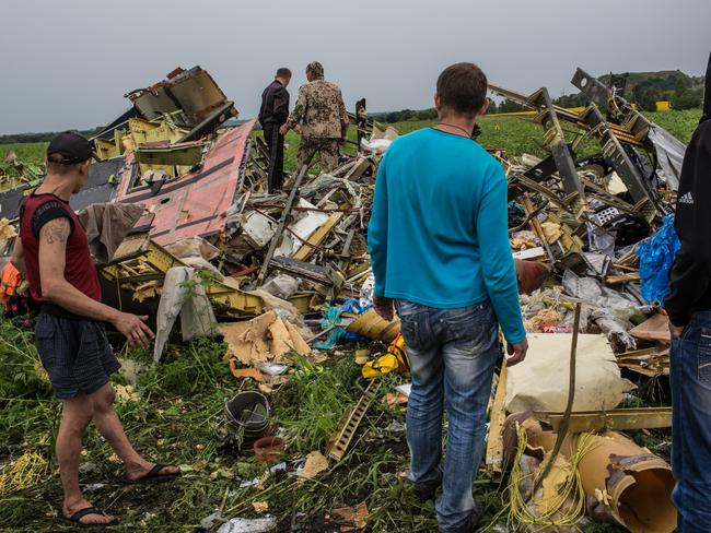 Locals picked through the wreckage of passenger plane Malaysia Airlines flight MH17 on July 18, 2014 in Grabovka, Ukraine. Picture: Brendan Hoffman/Getty Images