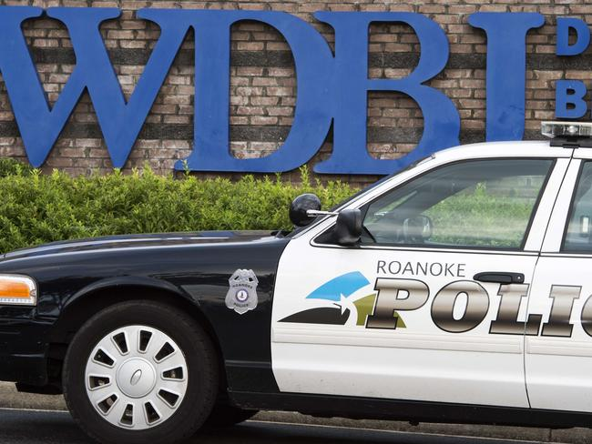TV HQ ... A police car outside the gate of WDBJ's television studios in Roanoke, Virginia. Picture: Paul J. Richards/AFP