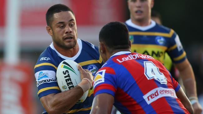 Jarryd Hayne of the Eels about to be tackled.