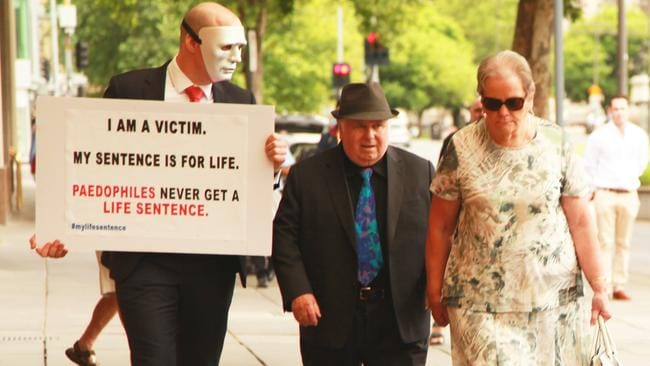 "The first masked confrontation between Brother ""B"" and Vivian Frederick Deboo, centre, in November last year."