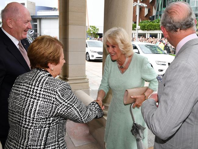 Prince Charles and the Duchess of Cornwall are greeted by the Governor-general Sir Peter Cosgrove and his wife Lynne on arrival in Brisbane. Picture: Dan Peled/AAP