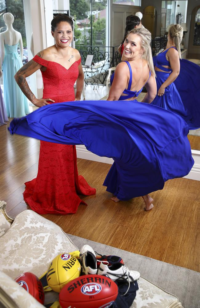 "PARTY TIME: Stevie-Lee Thompson and Abbey Holmes try on dresses at the After Dark Boutique in Myrtle Bank. Makeup and Hair by ""Makeup by Ali"". Picture: SARAH REED"